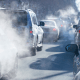 Air pollution flowing from the back of cars into the air