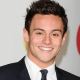 Olympic champion Tom Daley in a black tuxedo promoting a new trial into cannabis based drugs for brain cancer